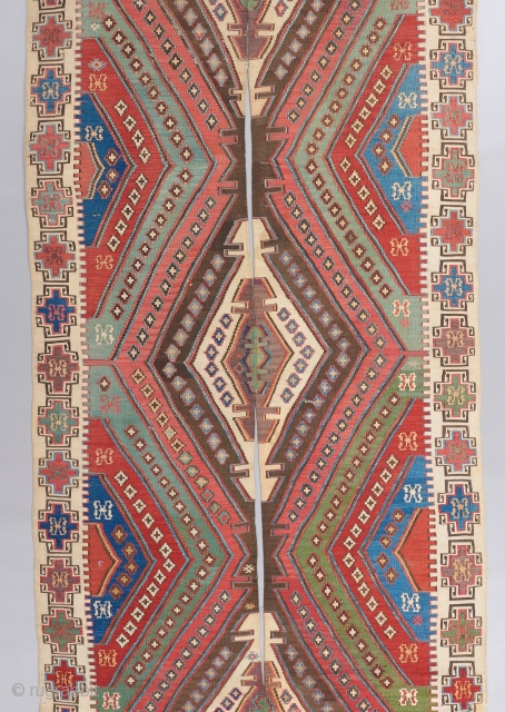 An early Anatolian Kilim in great condition woven in two panels. Great colors, great border,and rare to see one with the tassels fully intact. Quite fine as well. It has bits of  ...