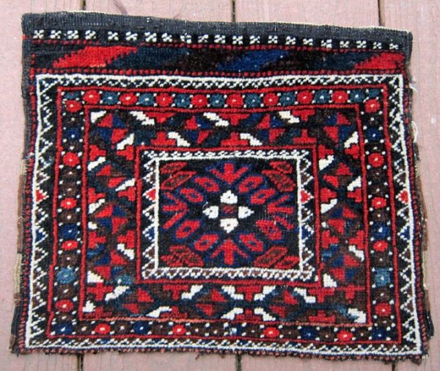 Very unusual little Baluch bag. Almost like a chanteh. Note the kilim design at the top which is not flatweave but pile. Great saturated all natural colors including green. Full pile except  ...