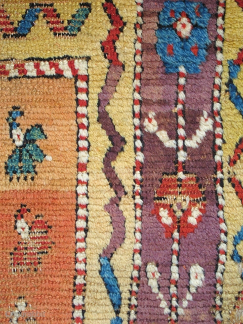 Vivid Saturated Color. Two matching fragments of an Anatolian Yatak, mounted together and conserved. multicolored carnations on a golden-saffron abrashed ground, perfect aubergine among the rainbow of colors.