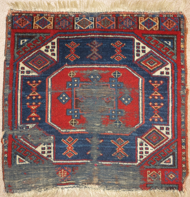 East Anatolian rug fragment, very fine weave and saturated natural color. An exceptionally elegant but battered older example of an iconic type.