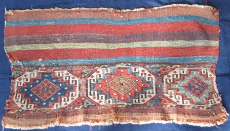 Colorful and very old fragment of a flat-woven East Anatolian chuval with well-drawn Memling guls and kilim stripes.