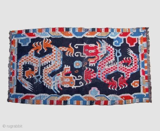 Tibetan Dragon Carpet 86 x 160 cm Early 20th century Wool Central Tibet A few repairs, beautiful colours, overall appearance good Feel free to ask for more information, for more textilesand antiques from Asia please visit my website  ...