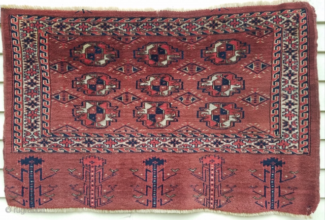 "Turkman nine gul chuval - about 44"" x 29"".  Evenly low pile, nice wool, interesting secondary guls and wonderful skirt.  Couple old mends."