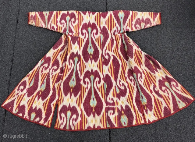 Beautiful Antique Uzbek Ikat Chapan (robe). Excellent natural colours and design. Offered reasonable price.