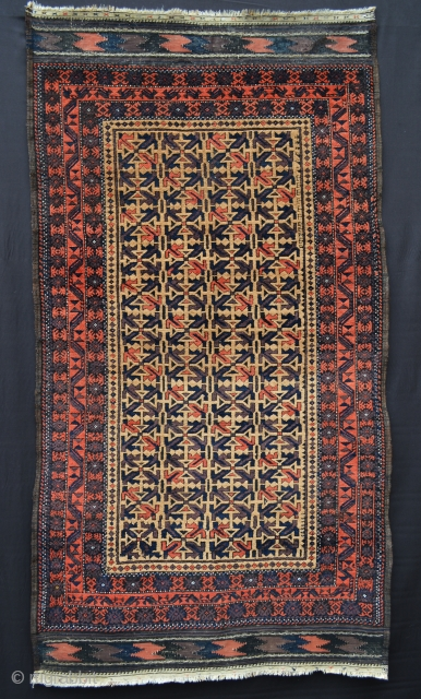 """Baluch rug with camel-hair field in very good condition bar an expert repair to one of the plain-weave chevrons - 1.82m x 0.97m (6' 0"""" x 3' 2""""). Price includes shipping."""