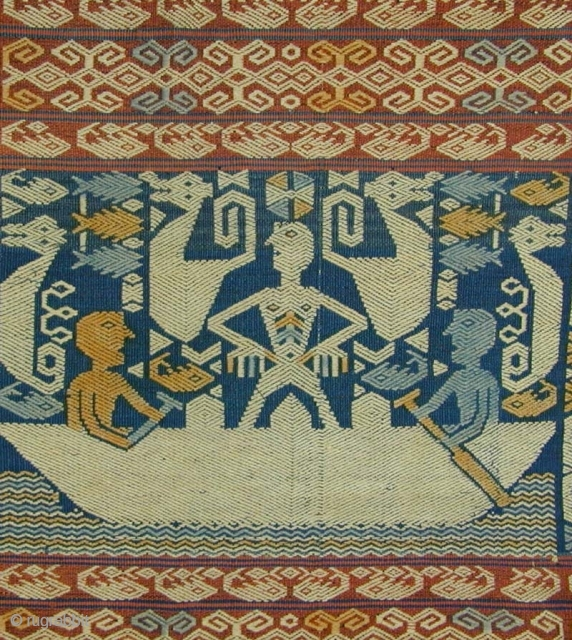 East Sumba Ceremonial Sash. Woven in supplementary-warp technique. Yellow and blue details are painted in after the weaving is completed. 199x57 cm. Mid-20th Century. Background colours are natural indigo and brown derived  ...