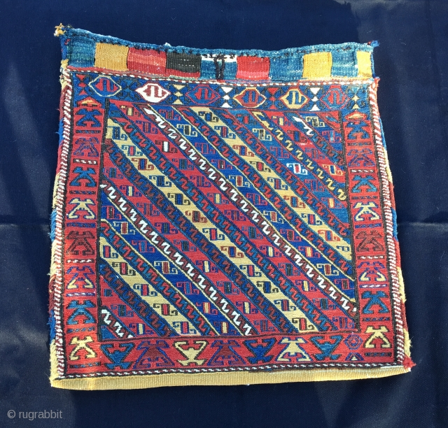 Sumack khorjin bag with original back. Cm 58x58. Late 19th century. Kurdish? Shahsavan? In any case a beautiful bag, with a rough, primitive weave and great colours.