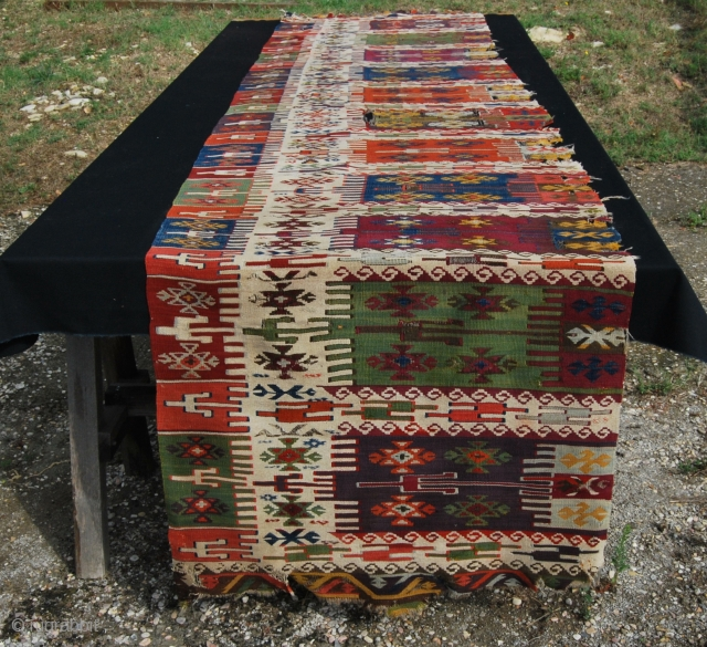 East Anatolia kilim strip. Cm 86x376 ca. First half 19th century. Wonderful colors, great pattern. Tears, holes, old moth problem, but still in good condition and definitely a fantastic piece, …..a museum  ...