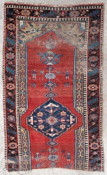 Fragment of Kurdish rug.  Origin : Kurdistan Period : before 1900 Size : 176 x 108 cm Material : wool on wool Worn fragment Handwoven  This rug has been cleaned by a professional.  ✦ Price and photos on www.christiandoux.com/products/kurdish-rug-176-108