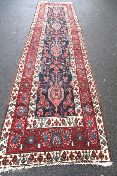 Old gallery from the North West Persia.  Origin : Persia Period : early 20th century Size : 420 x 107 cm Material : wool on cotton Good general condition Vegetable dyes Handwoven  This rug has been cleaned by a professional.  ✦  ...