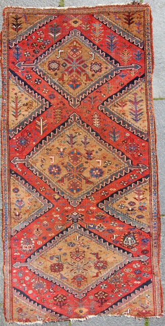 Very rare and possibly unique, small (170 x 80 cm), preconfedeartion khamseh with a lot of camel hair in the pile, woven on handtwined cotton warps-so it is very atypical. It is  ...