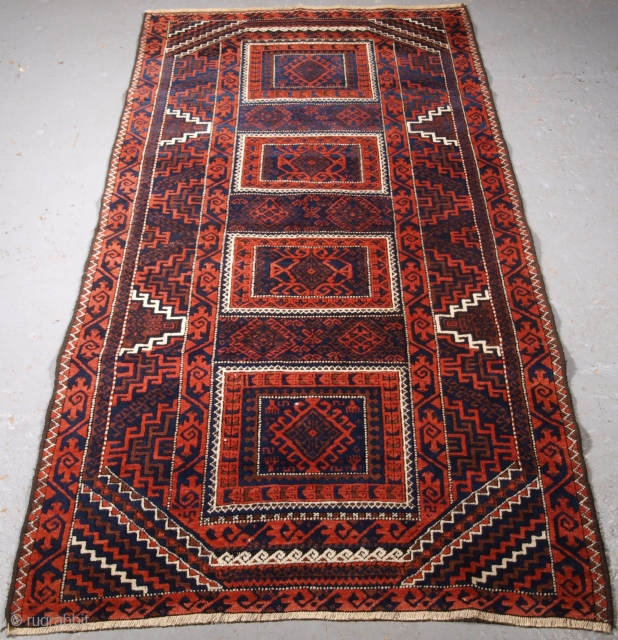Size: 6ft 2in x 3ft 3in (187 x 98cm). www.knightsantiques.co.uk   Antique Baluch rug with four compartments. A Baluch rug with good traditional Baluch colours with a traditional Baluch curled leaf border.  Circa 1900.  A  ...