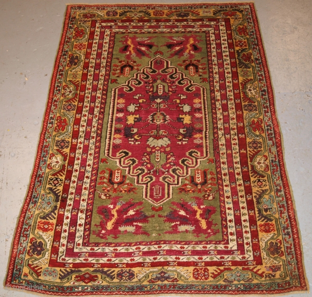 Antique Central Anatolian Kirsehir village rug of traditional design with great colour. www.knightsantiques.co.uk  Size: 5ft 9in x 3ft 11in (176 x 120cm). Late 19th century.  A good example of a Kirsehir rug with a  ...