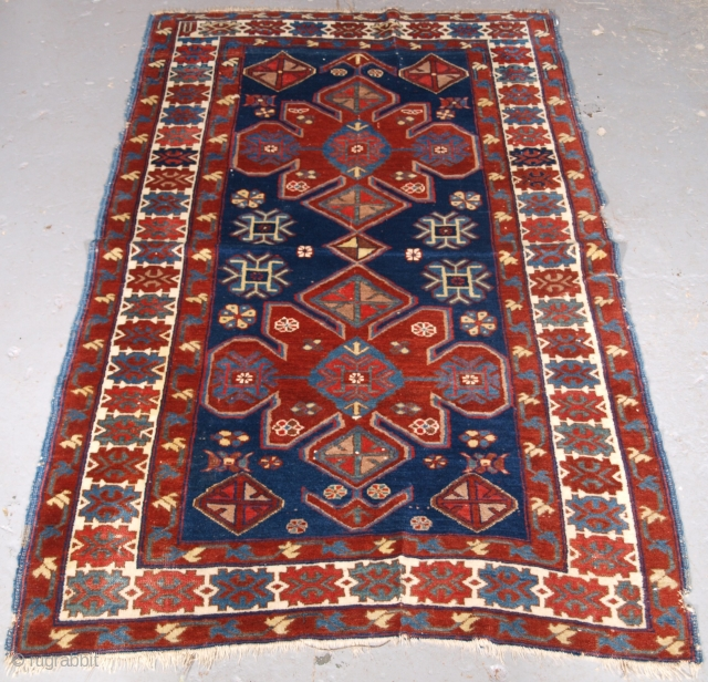 ***Spring sale*** £495.00 click the link www.knightsantiques.co.uk to view more items.  Size: 5ft 4in x 3ft 5in (163 x 103cm).  Antique Armenian Erivan rug with two design on a indigo blue ground.  Circa 1900.  A good  ...