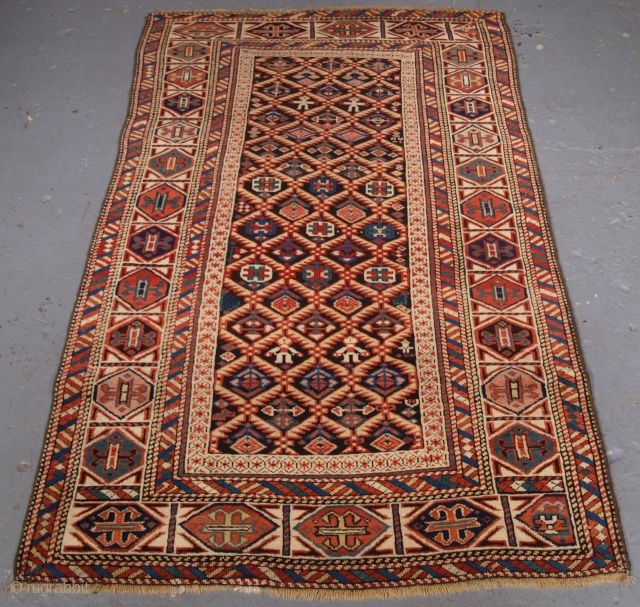 Size: 5ft 7in x 3ft 3in (171 x 98cm). Click the link www.knightsantiques.co.uk to view more items.  Antique Caucasian Dagestan rug with lattice design on a dark charcoal ground.   Circa 1880.  A very good  ...