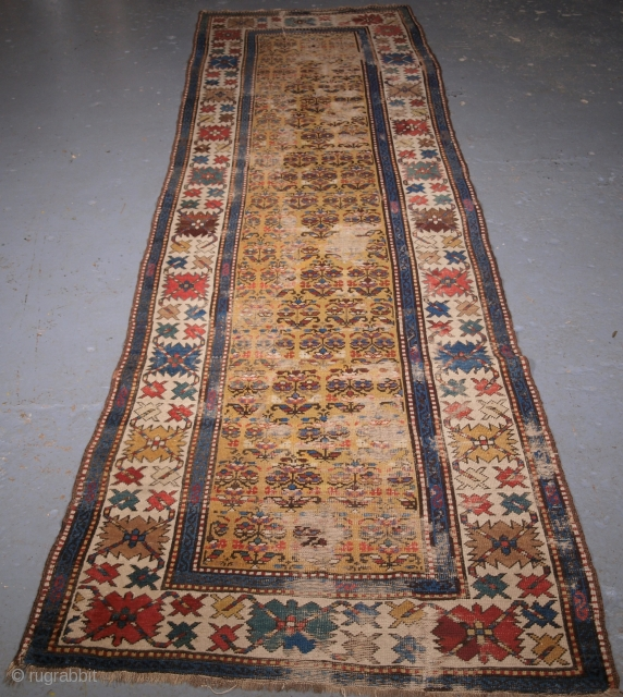 ***£395.00*** click the link www.knightsantiques.co.uk to view more items. Caucasian runner, yellow ground with shrub design. Heavy wear, old re-piling, creases, maybe worth restoring or just using as is. Size: 321 x  ...