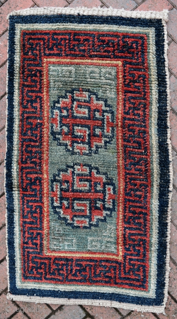 A rare green ground Tibetan saddle top from the Wangden valley. 19th century. Very good condition.