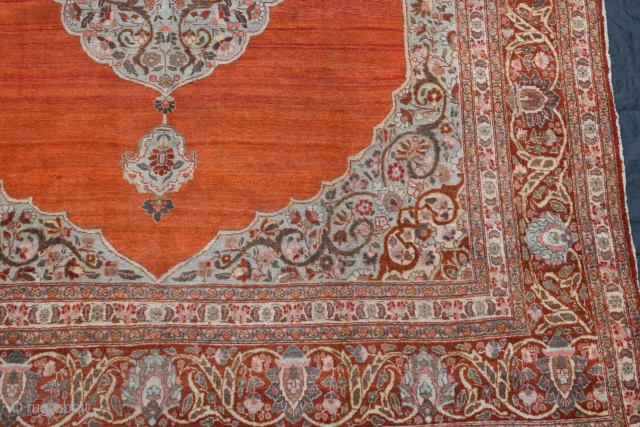 A fine antique Persian Tabriz carpet with soft colours and silky wool. A very clean carpet with even low pile, very slight moth damage here and there, but heavy and solid without  ...