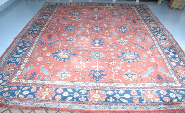 An Old 'Maples' Ushak carpet with soft dyes and allover design in good original condition., just slight wear in places and a few old moth nibbles. Now clean mothproofed and floor ready. Circa  ...