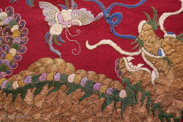 Chinese early 20th century embroidery.  Silk and gold thread.  Playful yet slightly ferocious fu dog design surrounded by 100 antique motifs.  Fish and butterfly motifs appear.  Base fabric  ...