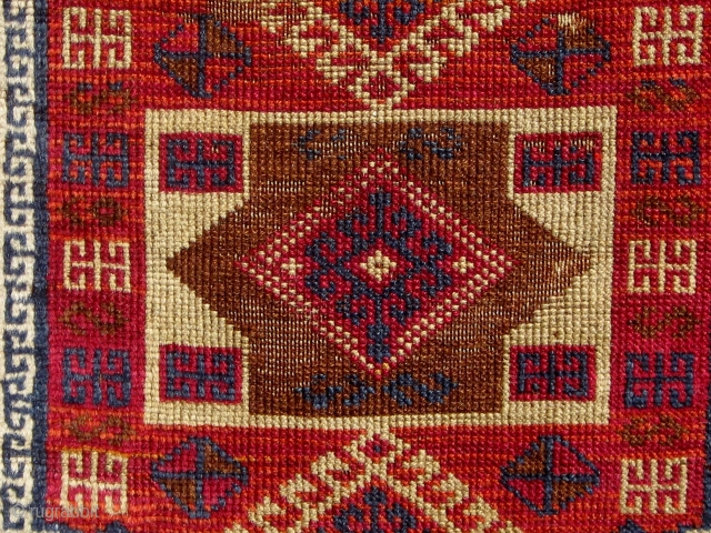 Antique Anatolian Kurdish yastik, from the Malatya area. Last quarter of the 19th Century.  All dyes appear natural with the possible exception of the highly saturated red in the outer border--difficult  ...