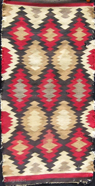 Antique Navajo rug, circa 1900-1910.  Obvious condition issues.  Please ask for additional photos.