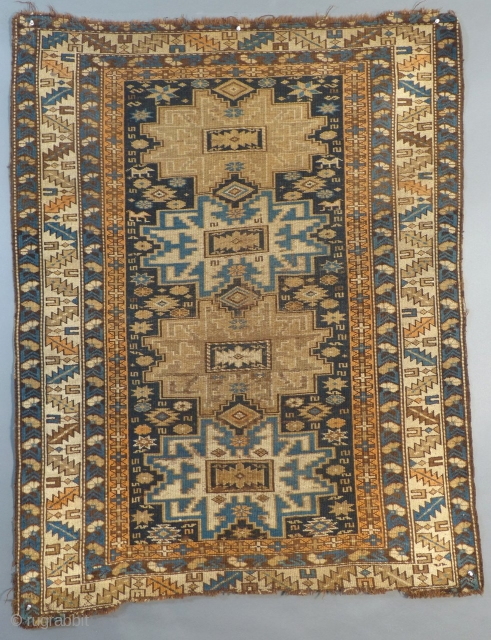 """Antique Caucasian Kuba with a Lesghi Star"""" design. It dates from around 1900-1915. It is in fairly good condition with NO holes, tears or stains. The ends are frayed out and uneven. It measures 56"""" X  ..."""