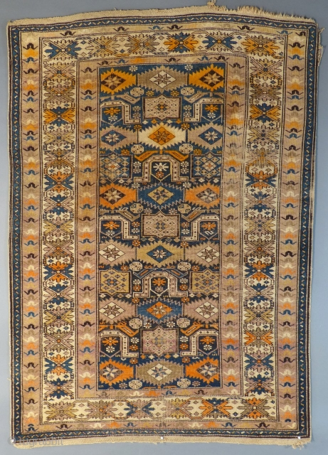 """This is an antique Caucasian Rug. It dates around 1900-1915. It measures 66"""" X 46"""". It has been use and shows light wear. It has some bleeding but no holes or tears. The ends retain most of  ..."""