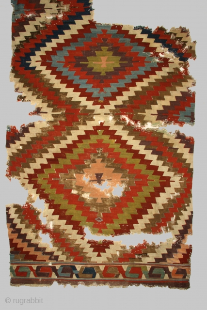 "Anatolian kilim, large fragment, 66 x 115 inches, 18th century. This is the earlist and most archaic example of a ""Baklava"" type kilim known to me."
