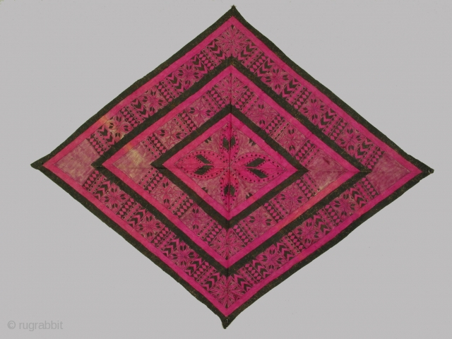 Man's headwrapper, Toradja culture, Sulawesi, Indonesia; barkcloth painted with natural colorants, circa 1900-1950, 44 x 56 inches. Such headwrappers were worn by headhunters  as ritual adornment when they went on headhunting forays.  ...