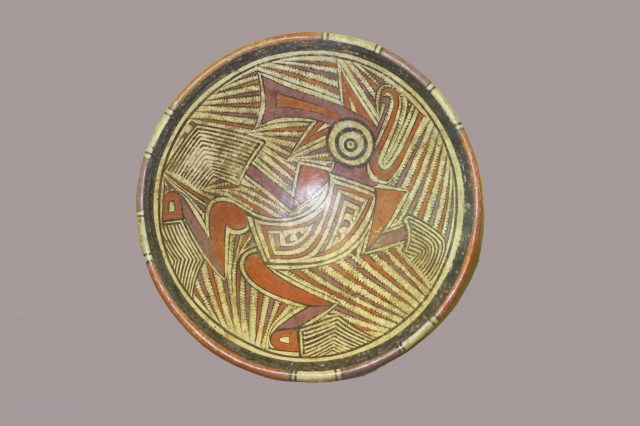 Panama, ceramic pedestal plate, Cocle culture, circa 800-1200 AD diameter 10 inches, foot 4 inches, depicting a shaman in transformation. One break and repair,