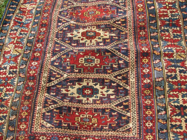 A colorful shirvan rug dated approx. 5x9