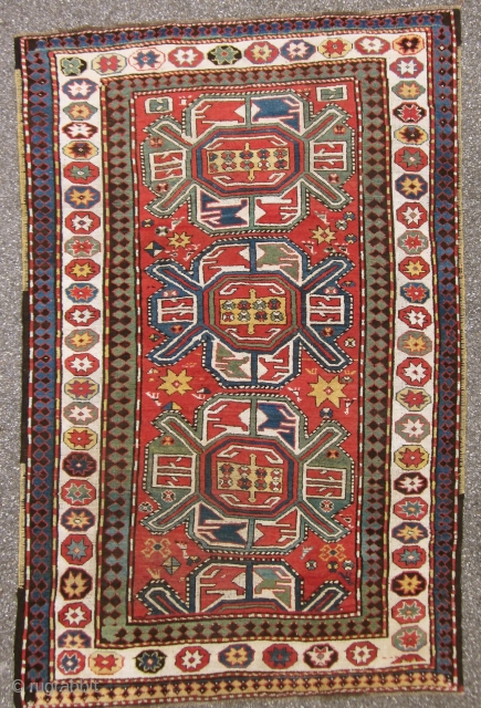 KARABAGH. Antique and well preserved with very limited wear. Almost high piled all over. All borders original.UNIQUE WHITHE BORDER WITH STARS! Size 234 cm x 158 cm SOLD