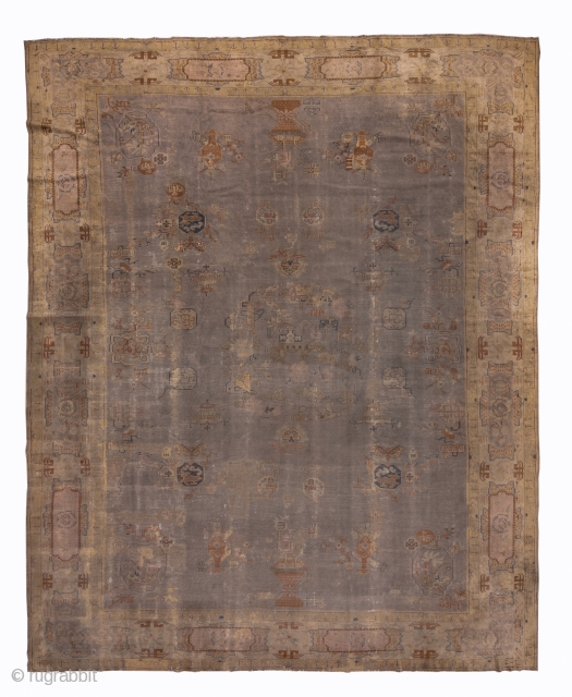 Indochinese Carpet  12.0 x 15.1 3.65 x 4.60  This rather enigmatic carpet is a study in earth-tones. It has certain Chinese design features, but the weave does not fit with anything from Ningxia, Peking or  ...