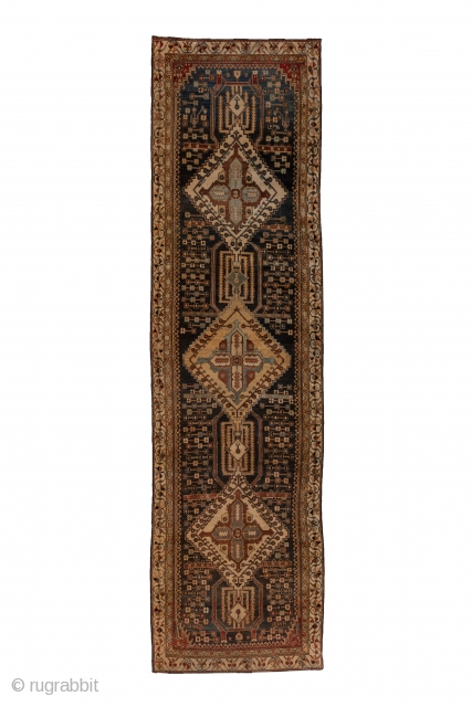 Baktiary Runner  3.9 x 13.8 1.18 x 4.20   This Chahar Mahal village kenare in lowish, but even condition, sports an abrashed dark blue ground centred on a pole medallion of three large, stepped, ivory  ...