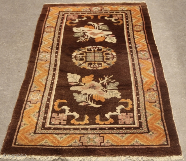 Baotao Rug Circa 1920/1930 Size: 1.45 x 0.76 ( 4'9 x 2'6) Simple little rug in browns and oranges.