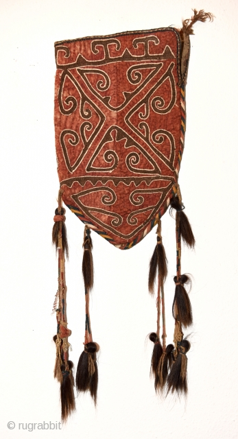 Uzbek felt okbash with horse tassels. Late 19th century. In very good condition and all natural colors. Size 55cm x 33 excluding tassels.