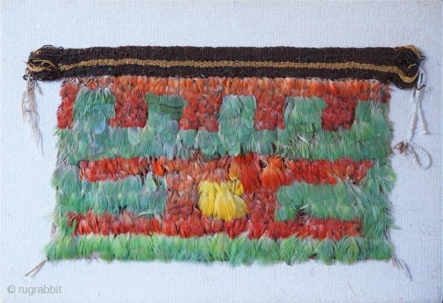 Pre-Columbian miniature feather mantle from Nasca. Presumed to be the mantle for a doll of grave goods. 20cm x 36cm