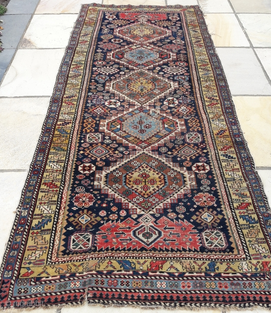 Last quarter 19th century Shirvan long-rug. Good pile, but distressed on one side, and rips to centre and bottom need attention. No hot colours. Approximately 3ft 6in by 8ft 6in