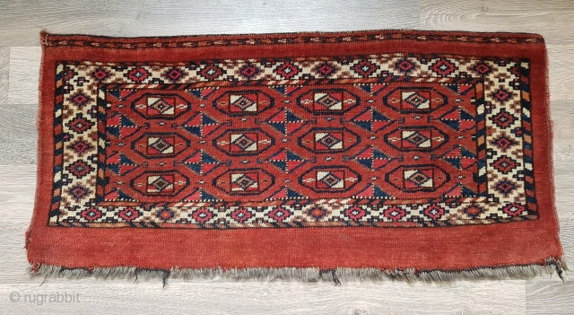 Antique 19th century Turkmen, probably Yomud group torba. Size is 39x80 cm (ca. 15x31 inches). Unusual design of primary and secondary guls in main field. In good condition with evenly worn pile  ...