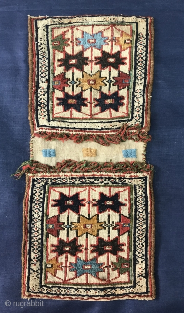 Qashqai mini khorjn 1870,with metal wire in the center of the stars,The white cotton background is a plain weave warp-faced while designing motifs star is woven in wool and technical Sumakh.size 54x24cm  ...