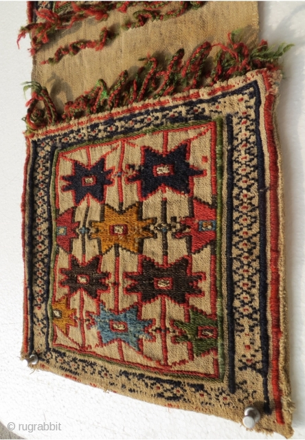 Shahsevan mini khorjn 1870,with metal wire in the center of the stars,The white cotton background is a plain weave warp-faced while designing motifs star is woven in wool and technical Sumakh.size 54x24cm