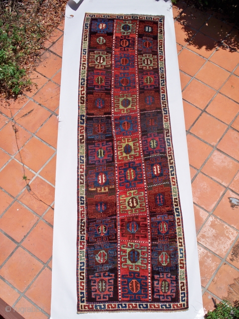 "Kurdish Rug (#317), East Anatolia, size 40"" x 139"" (101 cm x 353 cm), circa 1800, brilliant deeply saturated colors and the frequently encountered 'Kurdish Bend"" in the foundation, there are excellent  ..."