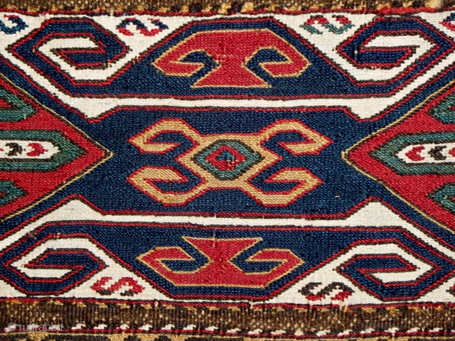 "Qarabagh mafrash end panel, 17"" x 17"", the weave is quite fine, the colors deeply saturated, the undyed cotton produces a strong visual contrast, good condition with several small, high-quality repairs, literature,  ..."