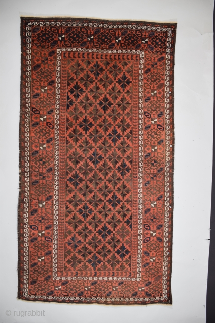 Baluch Rug - This example is a member of a small subset of symmetrically knotted weavings commonly called Aimaq-Baluch or Bahluli-Baluch. There is moderate warp displacement and a modest yet visually pleasing  ...