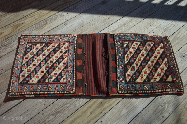 "A pair of Shahsavan Khorjin bags, measuring 22 1/2"" x 19 1/2"" each, total overall (connected) length is 52""."