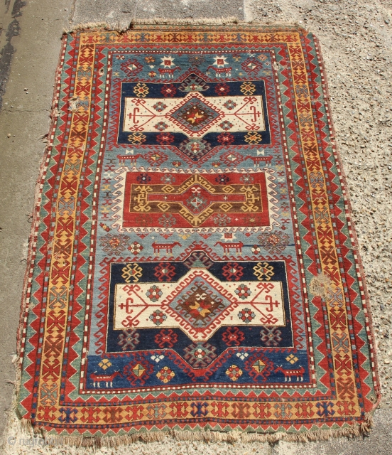 """Big 19th century Karachopf Kazak with lovely and unusual colours. Good pile but needs some holes fixing and edge work.   5'3"""" x 8'0"""" / 160 x 243cm"""