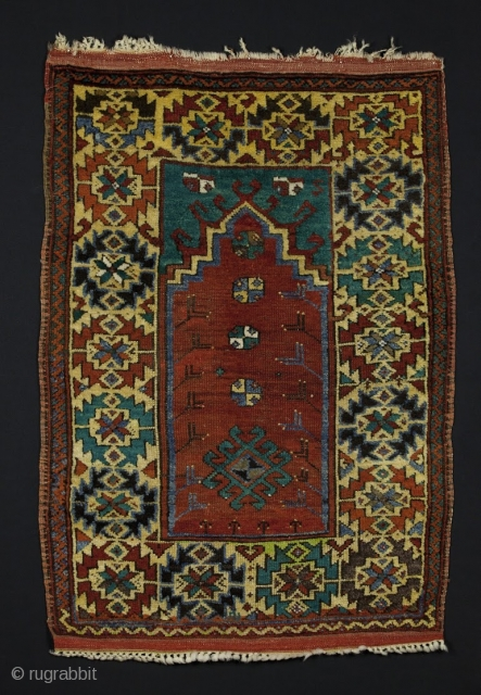 Central Anatolian Prayer Rug, circa 1900, 3' 2'' x 4' 5'', natural and synthetic dye mix.  Bold drawing, good pile condition.