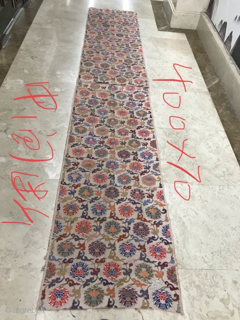 In the Qing Dynasty, the brocade embroidery with tangled branches and lotus pattern is made of white satin at the bottom, which is woven by makeup technology. The width is 70cm and  ...