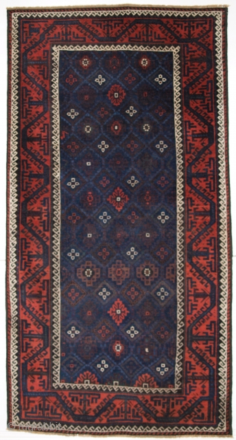 ANTIQUE BALUCH RUG WITH LATTICE DESIGN IN SUPERB BLUES, BOAT BORDER, LATE 19TH CENTURY. Size: 6ft 11in x 3ft 8in (212 x 112cm).  Antique Baluch rug from Western Afghanistan / Eastern Persia. A Baluch  ...